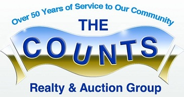 The Counts Realty and Auction Group Logo