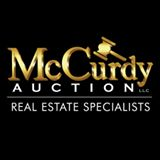McCurdy Auction, LLC Logo